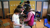 Students working on a Rubic Goldberg machine