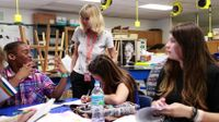 Teacher and students are working together in an afterschool class.