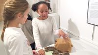 Two third grade girls from Friends School of Baltimore discuss a project about Native Americans.