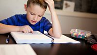 Boy frustrated over math homework