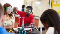 Students work together on a lab experiment.