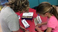Two girls exploring with littleBits circuits