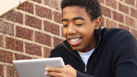Photo of high school student With iPad