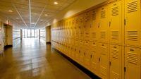 School corridor with yellow lockers lining both sides