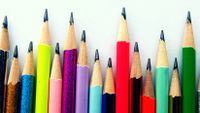 a row of colored pencils