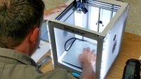 Man sitting setting up a design in the Ultimaker printer