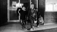 Photo of school children leaving building