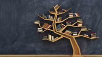 Image a bookshelf built in the shape of a tree positioned in front of a blackboard