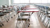 Neat rows of desks fill a classroom.