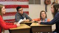 Katie Dulaney listens as her students have a discussion.