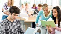 High school students read novels in class.