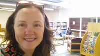 photo of a teacher-librarian in the library