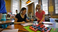 Students are working on a board game and puzzle game.