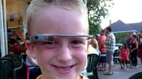 Boy wearing Google Glasses
