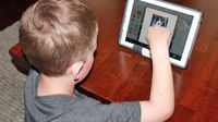 Boy watching a video on a tablet