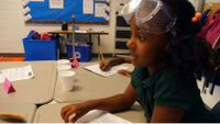A girl student is in a science class.