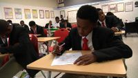 Students are working on their test in the classroom.