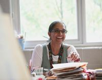 Teacher smiling at her desk