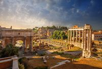 The ruins of the Roman forum, made up of marble columns and arches