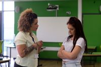 Teacher talking to a student about her oppositional behavior