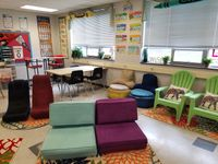 A flexible seating classroom with a variety of chairs, tables, rugs, and stools