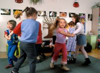 Elementary school children dancing in the classroom
