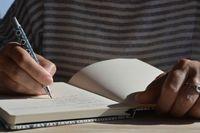 Teacher writing in a journal