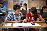 Two high school students work together in math class