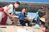 Students using cardboard in a school project