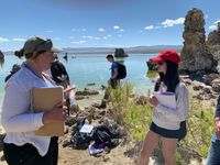 Ecology expert talking with a high school student at Mono Lake