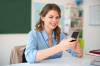 A teacher making a phone call on a cell phone
