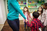 Teacher dancing with kindergarten students