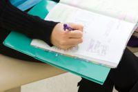 Teenager doodling in her journal
