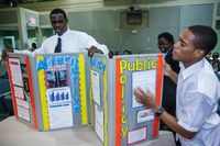 Two high school students give a presentation on public policy