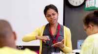 Young teacher instructing her class