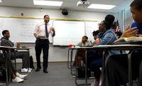 Teacher speaking in front of his class