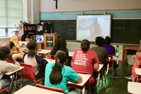 Classroom participating in a video chat via DreamWakers