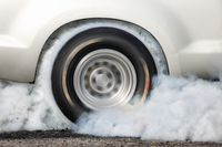 Spinning tires on a white car