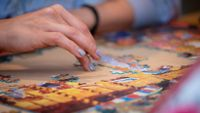 Woman working on a jigsaw puzzle