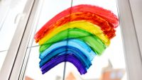 A rainbow painted on a house window during coronavirus quarantine
