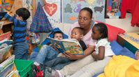 Preschool teacher reading to students