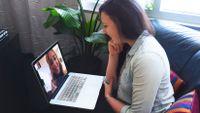Two women talking via video chat on a laptop