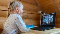 Elementary school student participating in a video chat with her class