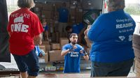 Volunteers sort and pack free books for low-income children