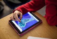 Student using a tablet to look at a map of South America