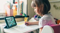 Young girl participating in class video chat during distance learning