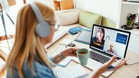Woman on video work call at home