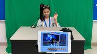 Girl student being a newscaster for class news program