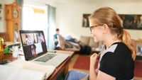 Middle grade aged girl distance learning on laptop at home