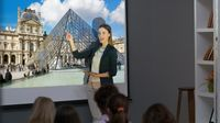 Teacher projects an image of the Louvre museum